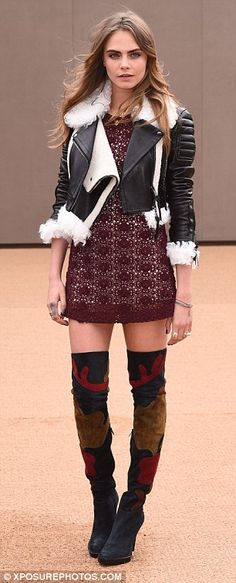 Stunning: The 22-year-old stunned in a pair of thigh high boots as she joined the crowd in...