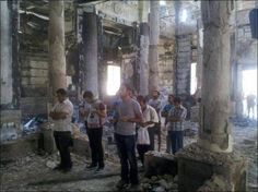 Young Coptic Christians praying in their church which was burned. This is St. George in Sohag, Egypt. What horrible sufferings are inflicted upon the Christians in Egypt!!