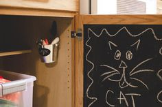 Clever way to keep kids busy while you're working in the same room with them.  A hidden cabinet chalkboard.