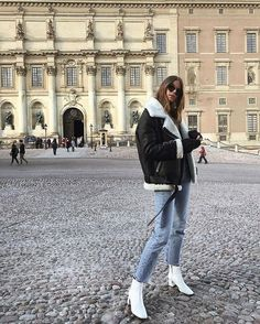 Leather shearling jacket, jeans and white shoes.