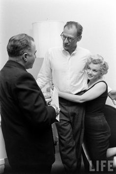 Marilyn Monroe and Arthur Miller with producer Kermit Bloomgarden in their New York apartment, 1958.