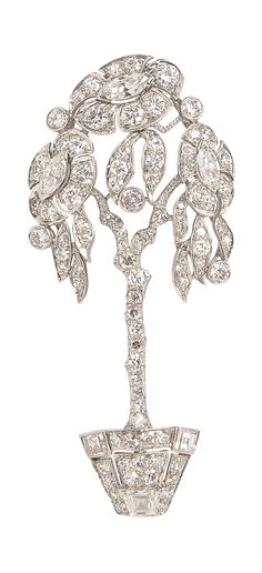 An Art Deco Platinum and Diamond Flowerpot Brooch, designed as a potted flowering tree with marquise-, full-, single-, and square-cut diamonds, lg. 2 in.