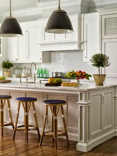 traditional white kitchen black pendant lights white marble counter