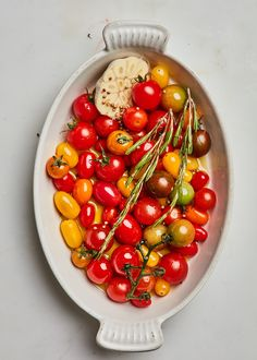 Douse cherry tomatoes in lots of olive oil and slow-roast to golden deliciousness. Get the recipe and read more about how to use them. Roasted Olives, Roasted Cherry Tomatoes, Roasted Almonds, Red Wine Vinegar Recipes, Cherry Tomato Recipes, Rosemary Recipes, Sauteed Zucchini, Vegetable Sides, Vegetable Recipes