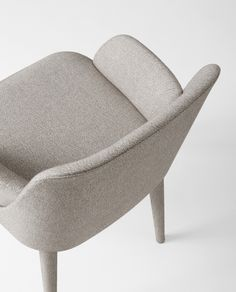 This modern armchair by Gallotti & Radice is available in a range of fabrics for the perfect look.