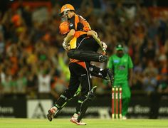 Michael Hussey and Adam Voges celebrate after Perth Scorchers beat Melbourne Stars off the final ball in the BBL semifinal #cricket #sports #australia