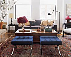digging this living room: chocolate couch, butter yellow pillows, persian rug and a pharmacy lamp