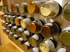 I like that this one uses glass jars, and that they are large enough! Magnetic Spice Rack from Apartment Therapy