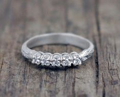 Diamond Twig Engagement Ring - Classic band with organic design - white gold band. $800.00, via Etsy.