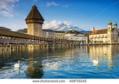 Chapel bridge is located on Lucerne historical city center, it's the famous and symbol of Switzerland's main tourist attractions. - stock photo