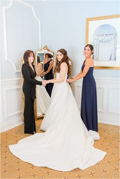 mom and sister help bride prepare for Farmingdale NJ wedding | Eagle Oaks Golf and Country Club in Farmingdale, NJ photographed by New Jersey wedding photographer Idalia Photography. Planning a classic wedding? Find inspiration here! #IdaliaPhotography #EagleOaksGolfClub #NJWeddingPhotographer