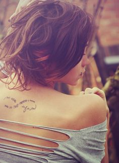 """Little back tattoo saying """"And in that moment I swear we were infinite"""" with the shape of the infinity symbol."""