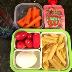 "#Teuko lunchbox: hard boiled egg, cherry tomatoes, fresh organic carrot cut in sticks, Penne pasta, ""round"" cheese, yummy strawberry fruit sauce, water. By Jessica, www.teuko.com"