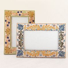 Textile artisan Seema handcrafts these richly textured tabletop photo frames using a combination of machine and hand embroidery, creating picture frames that add interest to any desk or shelf. An enti