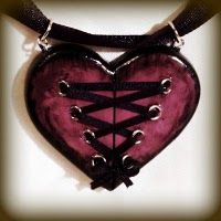 Heart corset pendant.  i see this in my future