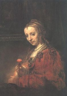 Woman with a Pink - Rembrandt