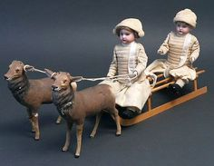 Two Candy Container Dolls on a Sled, pulled by two Reindeer.