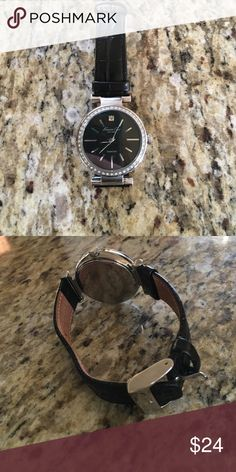 Women's Kenneth Cole watch Black wristband with black dial outlined in faux diamonds. Battery works Kenneth Cole Accessories Watches