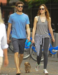 Pick those paws up: Leighton Meester and Adam Brody took their tiny wire-haired Dachshund Trudy for a walk in NYC http://dailym.ai/1nQqnW7