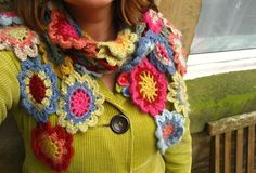 Just find a free flower pattern you like and use up all your stash and this could be done. With all the scrap yarn I have it will not cost me as much : )