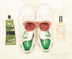 """Inside Stylist and Editor Liz Uy's Closet: Shoes, Adidas; Sunglasses, Karen Walker """"[For a long flight], I bring a small pot of moisturizer and a toothbrush and minty toothpaste. That's basically it. Then I sleep until I reach the country of destination.""""   coveteur.com"""