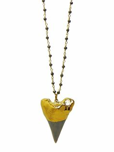 """24k Gold Dipped Shark's Tooth Featured on a metallic colored Pyrite beaded chain. Length: 32"""" *Due to the unique nature of the shark's tooth, the color and size will vary slightly from the photo."""