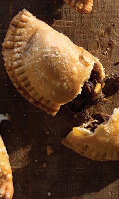 Tender, braised beef brisket is combined with raisins, sherry, pine nuts, and spicy chile powder in the fragrant filling for these sugar-dusted, savory-sweet empanadas.