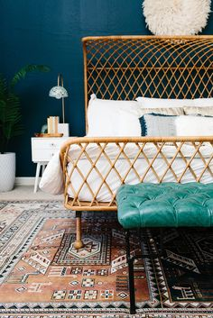 Blue bedroom with rattan bedframe