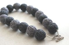 Grey short necklace beads of a thread cotton for women textile natural  toggl gray minimalism Geometry modern. $27.00, via Etsy.