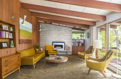 mid centurty stars homes   The living room of a remodeled midcentury modern home in Golden Valley ...