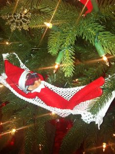 Hammock In The Christmas Tree Our little Elf decided to make a Hammock in our tree. I found my pajamas with a hole in them and my drawstring cut...Hmmm I wonder if he made himself a little Eye cover with them.. VOTE for your favorite photos in our Elf on the Shelf photo contest or submit your own elf photo for a chance to WIN Great Prizes at www.facebook.com/CoppinsHallmark