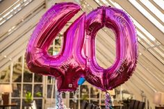 Large pink foil numbered balloons