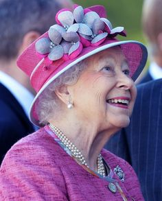 """Her Majesty during a visit to The Kelpies on July 5, 2017 in Falkirk, Scotland, to unveil a plaque to name """"The Queen Elizabeth II Canal""""."""