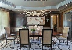 Transitional dining room with modern crystal chandelier, Los Angeles, California.