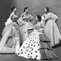 """From the 1951 Paris showings: """"Show-stoppers of collections were fabulous ball dresses like these Fath designs. The four above would cost the customer total of $5,100, are too expensive to reproduce, although some features, like flower-covered bodices, may be copied. Fath models, considered prettiest in Paris, all wore chignons with evening gowns."""" (Gordon Parks—The LIFE Picture Collection/Getty Images) #fashionfriday #jacquesfath"""