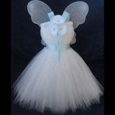 could this be any more perfect?? Flower Girl Dress Tiffany blue Tutu Weddings by StrawberrieRose...just an idea...at least without the wings