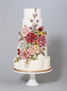 http://wedding-pictures.onewed.com/match/images/111400/stunning-wedding-cake-with-rich-floral-design.original.jpg?1357354069