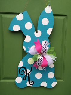 Celebrate Spring and Easter with this adorable hand painted monogrammed bunny wooden door hanger! Sealed with a weatherproof topcoat. Contact us with monogram.