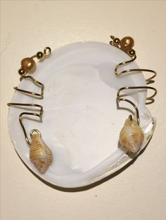 Ear cuff to be worn with conch shell near ear lobe. Cultured pearl and gold metal beads on non-tarnish gold wire $20