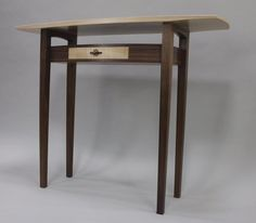 """""""flight"""" hall table made of walnut and ripple sycamore"""