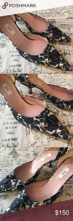 """PRADA floral print D'Orsay pumps 🌹 Gently used PRADA floral print D'Orsay pumps. Navy and white (more like an off-white now). Authentic. No box. Size 37.5 EU (7-7.5 in US). Slight discoloration at heel area due to normal wear. Kitten heel height: 2"""". Good condition. Perfect for PRADA shoe collectors, as this floral beauty is no longer available in stores. Prada Shoes Heels"""