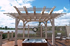 Pergola over hot tub with custom trelliswork screen.