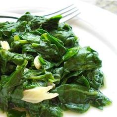 "Garlic Spinach | Thinly sliced garlic is a simple way to jazz up plain old spinach. With just a touch of butter and a quick stir, you'll have a dish that tastes great with just about anything!"" allrecipes.com/..."