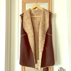 Brown  Suede Faux Fur Vest Ultra-chic and cozy! Deep brown suede with soft sheep wool! This vest is best when you're dressed down with a pair of jeans and tall sturdy brown boots. Excellent/like new condition. Worn once. Not quite sure of the exact size but it fits like M. Boutique Jackets & Coats Vests