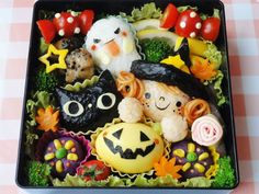 "Halloween bento with rice ball cat, witch, and ghost, plus dyed-egg ""pumpkin"" and tomato ""candy"" pieces ~ click-thru for more pics, lots of nice details! 