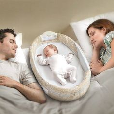Safe way for baby to sleep in bed with you on those rough nights.