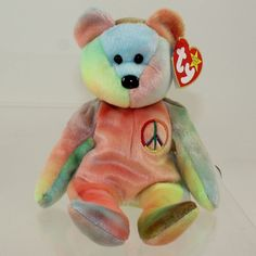 Beanie Babies are classic toys that seem to get more and more valuable as time goes on. Sell Beanie Babies, Most Expensive Beanie Babies, Beanie Babies Worth, Valuable Beanie Babies, Beanie Babies Value, Ty Babies, Peace Beanie Baby, Beanie Baby Bears, Ty Beanie Boos