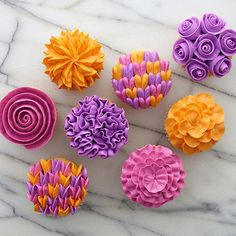 Flower Gallery Cupcakes - Transform a plain batch of cupcakes into a vivid bouquet using favorite Wilton flower-making techniques. The colors burst to life when you tint icing in spectacular spring shades using the Color Right Performance Color System.