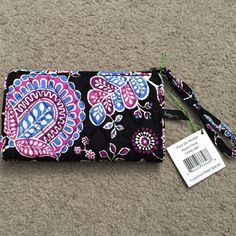 Vera Bradley Front Zip Wristlet Alpine Floral This chic wristlet has just enough room for all the essentials. The main zippered compartment offers six card slots and one bill pocket, while the front zip pocket is just the right size for stowing keys or a phone. Vera Bradley Bags Clutches & Wristlets