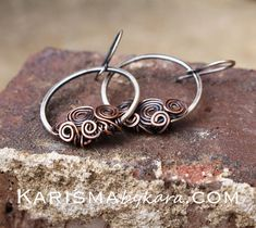These fun earrings are carefully crafted out of sterling silver and copper wire. They have been hammered, oxidized, polished, and finished with a wax coating. The earrings measure approximately 1 3/4 long from the top of the ear wire to the bottom of the hoop. The hoops are
